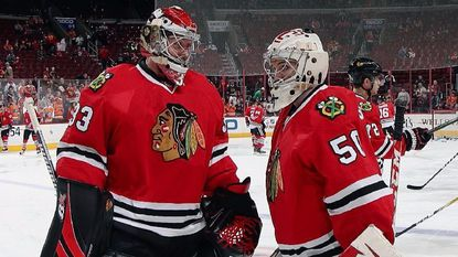 Blackhawks goalie Scott Darling (33) talks with Eric Semborski (50) during warmups before a game against the Flyers on Dec. 3.