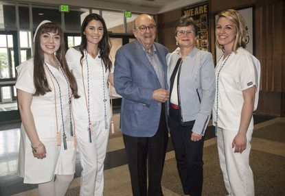 Dr. David and Alena Schwaber join nursing students Julia Akehurst, Katelyn Dietz and Katie Szabo at the May 2018 nursing pinning ceremony at Harford Community College. The Schwabers have endowed a $1 million scholarship for students studying nursing at the College.