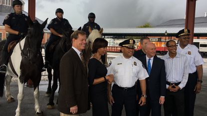 Mayor Catherine Pugh and other city and B&O Railroad Museum officials pose for a photo at the ceremonial groundbreaking for the police department's new $2.5 million stable for the mounted unit.