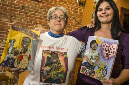 Kimberly Sheridan, left, with Shyla Channel, who is holding the portrait of her late father Gary Helmick