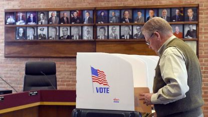 Tom Mitchell, an election official and Bel Air resident, makes his selections on his own ballot for the two openings on the Bel Air Board of Town Commissioners at Bel Air Town Hall on Tuesday, Nov. 7.