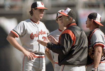 Orioles manager Joe Altobelli talks with Storm Davis, Ray Miller and Rick Dempsey during Game 4 of the World Series.