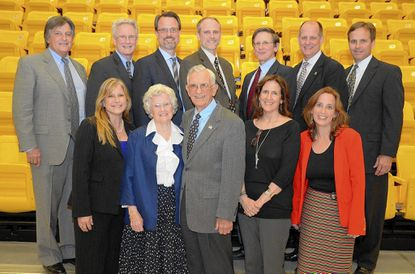 Members of the Lewis family, including seven Eagle Scouts, attended the Boy Scout event last week to honor Mary Agnes Lewis. They are, from left: top row, Dr. Rick Lewis , Tom Lewis, Mike Lewis, Jeff Lewis, Jim Lewis, Tim Lewis, Ted Lewis; and bottom row, Joan Lewis Kennedy, Mary Agnes Lewis, Dr. Fred Lewis, Lynn Lewis and Kathleen Lewis Schlichtmann.