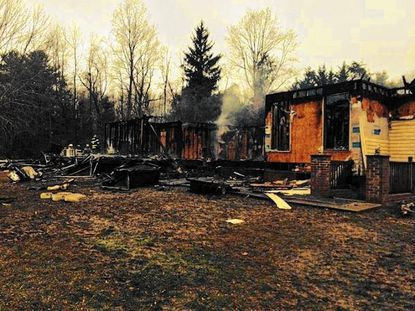 A home in Fallston is consumed by fire, which fire officials said caused an estimated $500,000 damage.