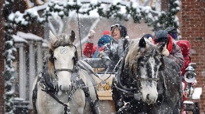 """A horse drawn carriage takes off from Locust Lane in Westminster as snow falls Saturday, Dec. 9, 2017. Free carriage rides are part of Westminster's """"Saturday's with Santa,"""" on Saturdays through Dec. 23. from noon to four."""