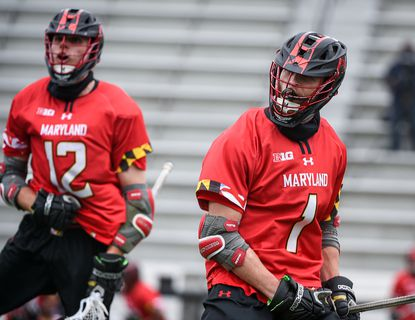 The Terps' Jared Bernhardt (1) celebrates a goal in the 4th quarter with teammate Logan Wisnauskas (12). The University of Maryland men's lacrosse team faces off with Johns Hopkins University on Saturday, April 24, 2021. The Terrapins won the game, 14-13.
