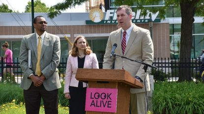 """Baltimore County Executive Johnny Olszewski Jr. speaks at a press conference announcing """"Look Alive,"""" a public awareness campaign promoting pedestrian safety."""