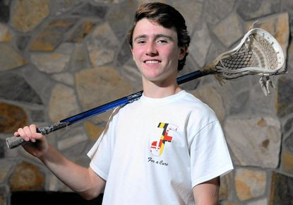 Jake Friedman, 17, a second team all-county boys lacrosse player as a junior at River Hill last spring, poses for a photo wearing a shirt he designed to raise money for the Crohn's and Colitis Foundation of America. Friedman was diagnosed with Crohn's disease in 2014.