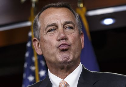 House Speaker John Boehner of Ohio responds to reporters about the impasse over passing the Homeland Security budget because of Republican efforts to block President Barack Obama's executive actions on immigration, Feb. 26, 2015, during a news conference on Capitol Hill in Washington.
