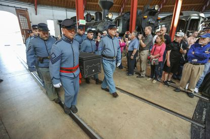 Reenactors carry an authentic replica of Abraham Lincoln's coffin at the B&O Railroad Museum's commemoration this past weekend of the sesquicentennial of Lincoln's funeral.