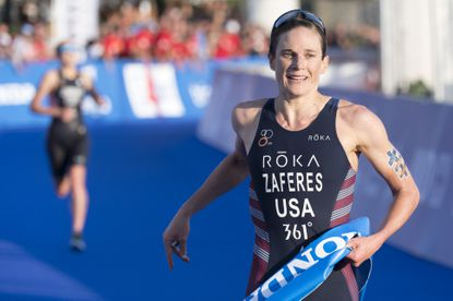 World champion Katie Zaferes of USA reacts as she crossing the finish line during the women's race of the 2019 ITU World Triathlon Grand Final in Lausanne, Switzerland, Saturday, Aug. 31, 2019. (Laurent Gillieron/Keystone via AP)