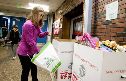Peyton Forthuber, a seventh-grader at Ridgely Middle School, puts five toys in the Toys for Tots donation boxes during the last day of the collection on Dec. 17. This was the first year that the school had an organized Toys for Tots drive. They hoped to fill one box of toys, but filled just about five boxes by the time the drive was over.