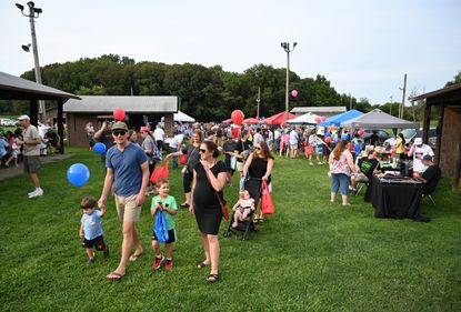 Families move about the grounds during the National Night Out event at the Sykesville Freedom District Fire Department on Tuesday, August 3, 2021.