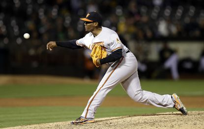 Orioles pitcher Mychal Givens works against the Oakland Athletics in the ninth inning.
