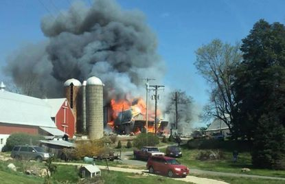Fire engulfs a storage barn on the Reeves farm in Forest Hill Wednesday, as shown in this photograph taken by Scott Stevenson.