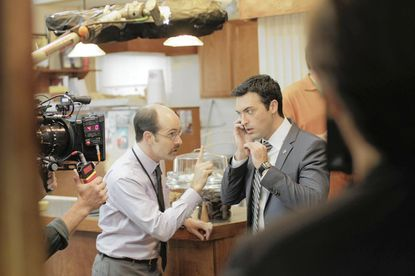 A behind-the-camera look at a scene featuring Reid Scott, who plays an aide to vice president Selina Meyer.