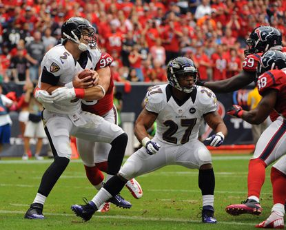 Ravens quarterback Joe Flacco is sacked by Texans' Connor Barwin in the end zone for a safety in the first quarter.