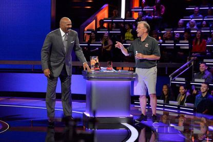 """Steve Harvey, host of """"Steve Harvey's Funderdome,"""" left, laughs with Steve McLaughlin, inventor of Court Grabbers, on an episode of the show which will air on July 23 on ABC."""
