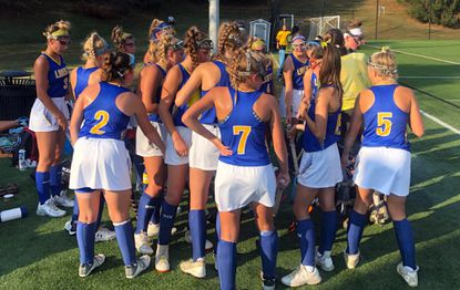 Liberty's field hockey team huddles together during a game against McDonogh on Tuesday, Oct. 1 that the Lions won 2-1 in overtime.