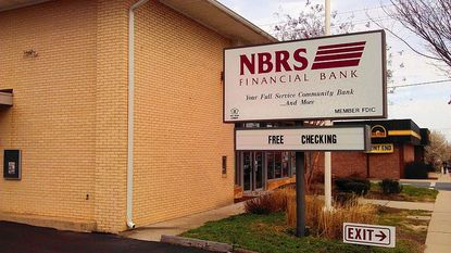NRBS Financial Bank, which operates this branch in Aberdeen, has been ordered by the Federal Reserve to shore up its capital reserves or consider merging or being taken over by another bank.