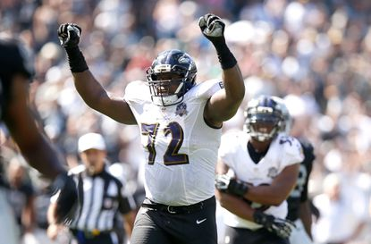 Ravens offensive lineman Kelechi Osemele (#72) celebrates a touchdown in the second quarter against the Oakland Raiders. Osemele, previously the left guard, is getting a tryout at left tackle in the final quarter of the Ravens' season.