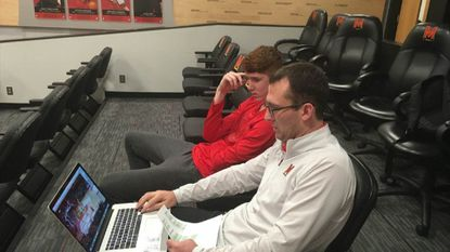 Maryland assistant coach Dustin Clark and freshman Kevin Huerter review plays in the team lounge after practice from a 2016-17 win at Illinois