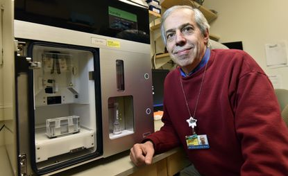 Baltimore, Md. -- Dr Donald Zack, co-director of Center for Stem Cells and Ocular Regenerative Medicine at Johns Hopkins Wilmer Eye Institute, is leading a study that is growing eye cells in the lab and one day could help develop therapies that could stop blindness. Zach shows a cell sorter in his lab at the Smith Building.