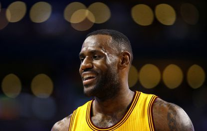 Cleveland Cavaliers forward LeBron James smiles during the second quarter of his team's 89-77 win over the Boston Celtics Tuesday night.