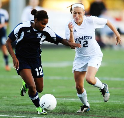 Perry Hall's Taylor Coles, left, tries to force Catonsville's Jennifer Nonn away from the ball during the regional semifinal soccer match at Catonsville High School.