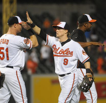 Lew Ford congratulates Nate McLouth after the Orioles beat the White Sox. Both players hit homers in the victory.