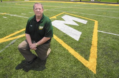 McDaniel College's has a new head football coach and a new turf field. Mike Dailey is pictured with the school's new field on Tuesday, July 12, 2016.