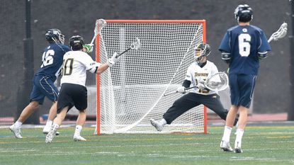 Georgetown attackman Robert Clark scores a goal on Towson goalkeeper Josh Miller. Towson's 12-10 loss to the Hoyas on Saturday will likely drop the No. 19 Tigers out of the Maverik Inside Lacrosse media poll's Top 20.