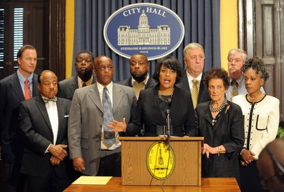 """Mayor Stephanie Rawlings-Blake held a press conference after the City Council voted to give final approval to $107 million in tax-increment-financing bonds for Harbor Point, a high-end development. Next to her at left is Bernard C. """"Jack"""" Young, City Council president. At right (in black dress is City Council member Rochelle """"Rikki""""v Spector. At far left in back row is Michael S. Beatty, president of Beatty Development Group, LLC."""