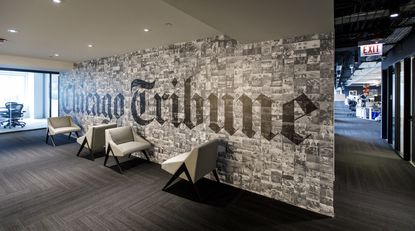 A wall of the Chicago Tribune newsroom is seen June 12, 2018, at One Prudential Plaza in Chicago. Tribune Publishing, the newspaper's parent company, has called a special meeting of its board of directors for July 1, 2020, hours after the expiration of a standstill agreement with Alden Global Capital.