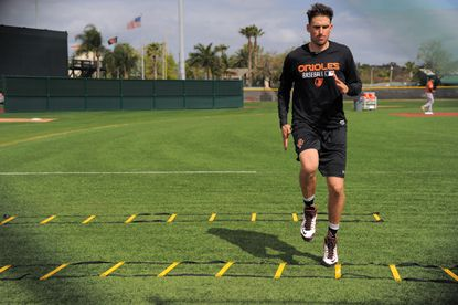 Baltimore Orioles infielder Ryan Flaherty exercises during spring training practice at the Ed Smith Stadium complex.