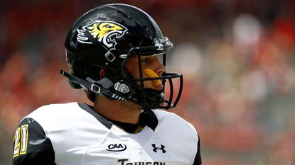 Towson quarterback Ryan Stover walks off the field after not being able to convert for a first down in the first half of a game against Maryland in College Park on Saturday, Sept. 9, 2017.