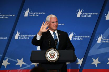 Vice President Mike Pence speaks to GOP representatives Friday at a three-day retreat in Baltimore.