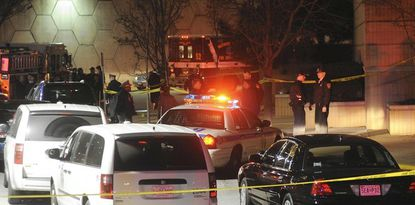 Baltimore County police investigate a shooting scene outside Nordstroms at Towson Town Center Monday.