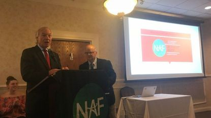 Maryland Comptroller Peter Franchot, left, and Mike Martin, who's in charge of the Academy of Finance at Lansdowne High School, at the program's annual luncheon.