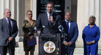 Baltimore County Executive Johnny Olszewski announces plans to introduce legislation that will make housing discrimination illegal. Standing behind him are, from left, Councilman Izzy Patoka, Marsha Parham-Green, Executive Director of the Baltimore County Office of Housing, Councilman Julian Jones and Sharonda Ellerby, a former Section 8 recipient who is now a business owner. The event is outside the Historic Courthouse on October 4.