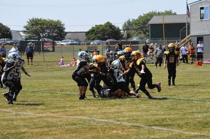 Scenes like this, involving the Westminster Wildcats 8-under youth football team, won't be seen this fall as tackle football was banned in an effort to mitigate transmission of COVID-19.