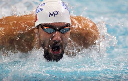 Michael Phelps swims during the men's 200-meter butterfly at the finals of the Arena Pro Swim Series at the University of Minnesota on Friday, Nov. 13, 2015, in Minneapolis.
