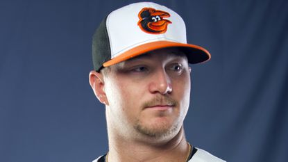 Orioles minor league right-hander Mike Wright was added to the club's 40-man roster Thursday.