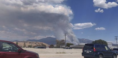 A plume of smoke from the El Dorado Fire is seen from the Interstate 10 in Loma Linda, Calif., on Sept. 5, 2020.