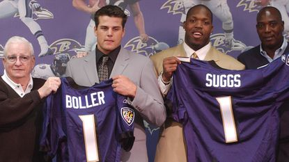 Left to right, Ravens owner Art Modell, No. 19 overall pick Kyle Boller, a quarterback out of California, No. 10 overall pick Terrell Suggs, a linebacker out of Arizona State, and general manager Ozzie Newsome pose during a news conference April 27, 2003, in Owings Mills.