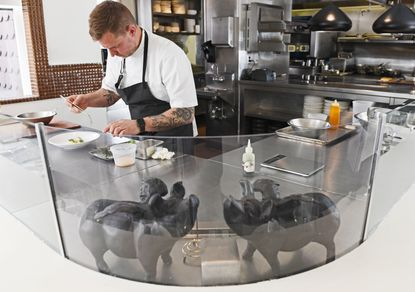 Chef/owner Bryan Voltaggio plates a dish at Volt located at 228 N. Market Street in Frederick.