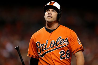 Steve Pearce #28 of the Baltimore Orioles reacts after striking out in the eighth inning against the Washington Nationals at Oriole Park at Camden Yards on July 11, 2015 in Baltimore, Maryland.