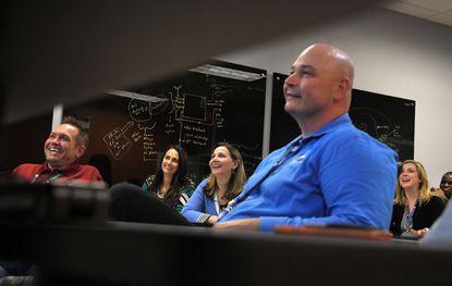 Dan Lienert, from left, owner and co-founder of IntelliGenenis, Sarah Rumann, Dawn Hetzer, Jeremiah Jensen, Mary Anne DeHart and Guy Howard in the companies training center.