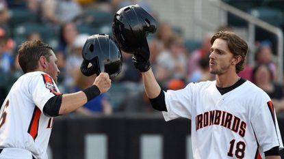 IronBirds' Zach Watson, right, celebrates his lead-off home run with teammate Toby Welk during the New York-Penn League game against Connecticut at Ripken Stadium on Wednesday.