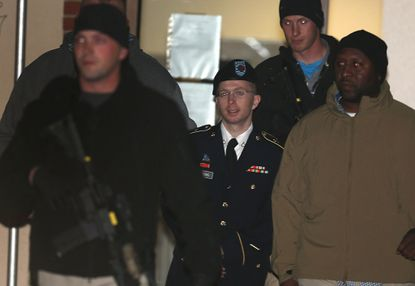 Pfc. Bradley E. Manning is escorted from a hearing, on November 27, 2012 in Fort Meade, Maryland. Manning attended a motion hearing in the case of United States vs. Pfc. Bradley E. Manning, who is charged with aiding the enemy and wrongfully causing intelligence to be published on the Internet.